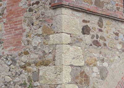 Limestone quoins in a rubble wall.