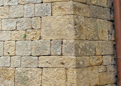 Beautifully cut corner stones in the wall surrounding Volterra.