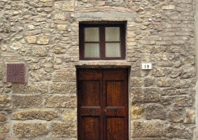 A doorway and wall in Volterra.