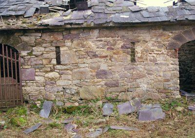 The ruins of a fieldstone barn.