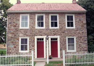 A very symmetrical fieldstone house. Did they build duplexes in the18th- and 19th-century?