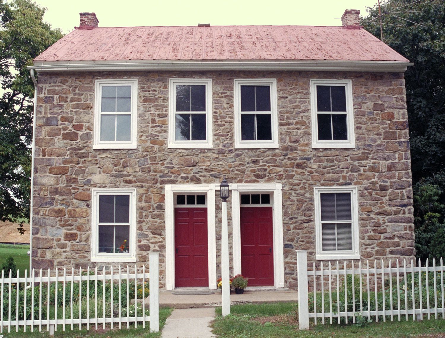 A very symmetrical fieldstone house. Did they build duplexes in the18th-  and 19th-