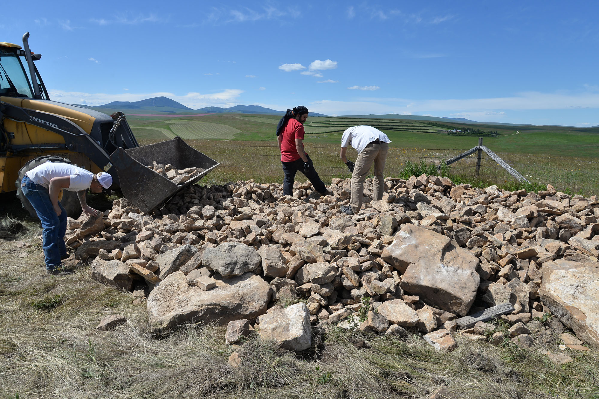 Stone from the piles is hand-picked for processing.