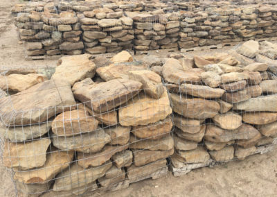 The larger stones are separated and palletized as Homestead Oversize Wall Stone.