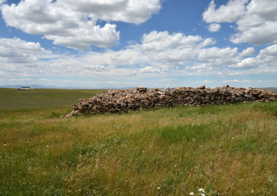 Piles of Homestead Fieldstone are the remains of decades of clearing from the fields.