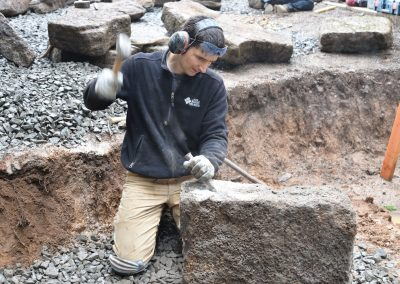 Chiseling basalt blocks